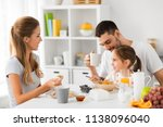 family  eating and people... | Shutterstock . vector #1138096040