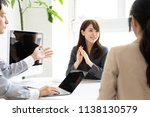 asian business group meeting in ... | Shutterstock . vector #1138130579