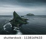 a green moss and grass covered... | Shutterstock . vector #1138169633