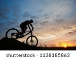 silhouette of a bicyclist... | Shutterstock . vector #1138185863