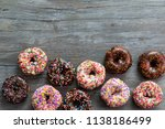 Assorted Donuts On Wood...