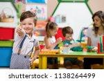 preschool children and teacher... | Shutterstock . vector #1138264499