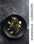 black pasta  squid ink  with... | Shutterstock . vector #1138302290