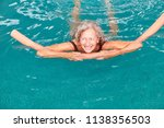smiling senior woman in the... | Shutterstock . vector #1138356503