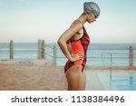 side view of fit woman swimmer... | Shutterstock . vector #1138384496