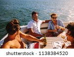 young people partying on a boat.... | Shutterstock . vector #1138384520