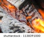 burning firewood in a brazier | Shutterstock . vector #1138391000