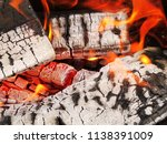 burning firewood in a brazier | Shutterstock . vector #1138391009