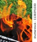 burning firewood in a brazier | Shutterstock . vector #1138391030