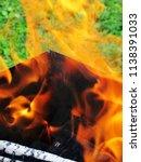 burning firewood in a brazier | Shutterstock . vector #1138391033