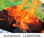 burning firewood in a brazier | Shutterstock . vector #1138391036