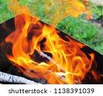 burning firewood in a brazier | Shutterstock . vector #1138391039