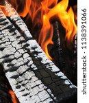 burning firewood in a brazier | Shutterstock . vector #1138391066