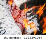 burning firewood in a brazier | Shutterstock . vector #1138391069