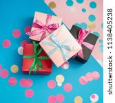 decorated boxes and confetti on ... | Shutterstock . vector #1138405238