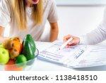 doctor nutritionist  dietician... | Shutterstock . vector #1138418510