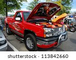 FREDERICK, MD- SEPTEMBER 16: 2003 Red Chevy Silverado on September, 2012 in Frederick , MD USA. Alzheimer's Association Benefit Car Show at Motor Vehicle Administration in Maryland. - stock photo