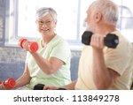 Vital Senior Couple Exercising...