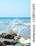 Sea Waves Break On Stones