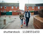 little girl and her father are... | Shutterstock . vector #1138551653