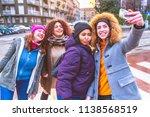 four young women multiethnic... | Shutterstock . vector #1138568519