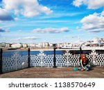 tourist girl wait someone at... | Shutterstock . vector #1138570649