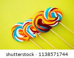 colorful hard candy lollipop on ... | Shutterstock . vector #1138571744