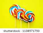 colorful hard candy lollipop on ... | Shutterstock . vector #1138571750