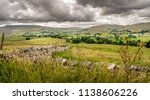 Stone Wall With Fields And...