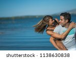 romantic couple playing... | Shutterstock . vector #1138630838