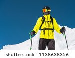 skier standing on a slope. man... | Shutterstock . vector #1138638356
