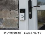 Small photo of New York, USA - Circa 2018: Ring video doorbell owned by Amazon. manufactures home smart security products allowing homeowners to monitor remotely via smart cell phone app. Illustrative editorial