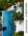 blue door in courtyard | Shutterstock . vector #1138692683