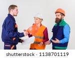 builders and engineer arguing ... | Shutterstock . vector #1138701119
