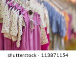 Dresses for young girls in kids mall - stock photo