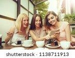 two girl friends spending time... | Shutterstock . vector #1138711913