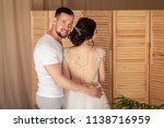 the bridegroom embraces the... | Shutterstock . vector #1138716959