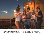group of young friends having a ... | Shutterstock . vector #1138717598