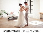 the bride dresses the dress... | Shutterstock . vector #1138719203