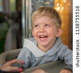 baby boy sitting in high chair... | Shutterstock . vector #1138755518