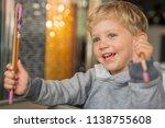 baby boy sitting in high chair... | Shutterstock . vector #1138755608