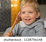 baby boy sitting in high chair... | Shutterstock . vector #1138756148