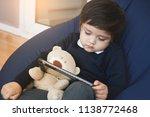 cute boy wearing school uniform ... | Shutterstock . vector #1138772468