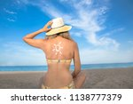 woman sunbathing on the beach | Shutterstock . vector #1138777379