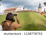 girl takes pictures on the... | Shutterstock . vector #1138778753
