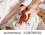 hands of a family  mother ... | Shutterstock . vector #1138780520
