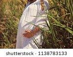a pregnant woman | Shutterstock . vector #1138783133