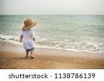 child sea beach coast sand hat... | Shutterstock . vector #1138786139