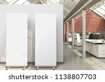 blank roll up banner stands in... | Shutterstock . vector #1138807703