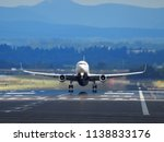 an airplane to take off from... | Shutterstock . vector #1138833176